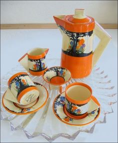 Clarice Cliff, Bizarre ware. Art Deco Tea Set.Now that I found a tray for the stand and I have a coffee table, I need something for on top of it and this is just lovely!!!