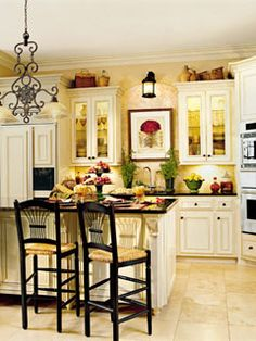 Long cabinetry-cream makes room feel airy and open. The black grounds it and add a gorgeous contrast.