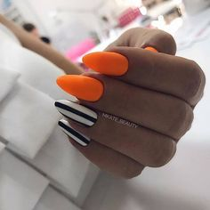 There are three kinds of fake nails which all come from the family of plastics. Acrylic nails are a liquid and powder mix. They are mixed in front of you and then they are brushed onto your nails and shaped. These nails are air dried. Orange Acrylic Nails, Summer Acrylic Nails, Cute Acrylic Nails, Fun Nails, Halloween Acrylic Nails, Orange Nail Art, Holloween Nails, Neon Orange Nails, Acrylic Colors