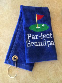 A personal favorite from my Etsy shop https://www.etsy.com/listing/221525477/personalized-golf-towel-par-fect-grandpa