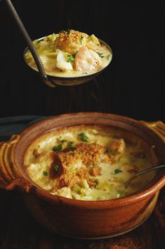 Low-Carb Baked Seafood Casserole Recipe -In a serving spoon with Casserole in the background.