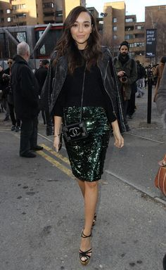 Ashley Madekwe in a Topshop skirt, Burberry Brit moto jacket, Chanel cross-body, and Charlotte Olympia platforms