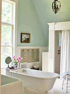 This grand bathroom features a traditional claw-foot tub with beautiful views of the outdoors. More cottage bathroom ideas: http://www.bhg.com/bathroom/decorating/cottage/country-bathroom-design-ideas/?socsrc=bhgpin070113tubwithaview=5