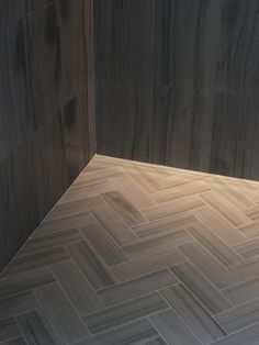 Zebra Gray is a limestone featuring dramatic linear striations, from Italian manufacturer Slabs, tiles and mosaics can be combined within a space, allowing for both variety and continuity. Gray Shower Tile, Grey Flooring, Fun Decor, Hardwood Tile, House Flooring, House Inspiration, Herringbone Tile, Flooring, Herringbone Tile Floors