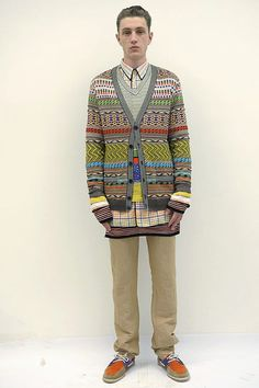 the combination of colours in pale pink, yellow, green, orange contrasted with graphic black patterns. Missoni Menswear