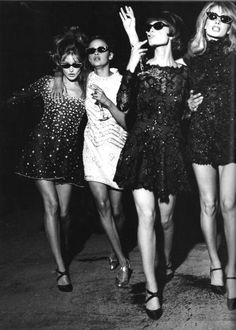 Models as party girls: The night is young; let's have one more cigarette, one more flute of champagne. This photo from Vogue Italia September 1994 doesn't mention names, but from left to right they look like Carla Bruni, Nadege, Christy Turlington and Claudia Schiffer. All dresses by Lancetti.
