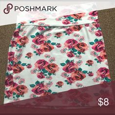 Floral Skirt NWOT. Never worn, perfect condition. Be warned this skirt will show if you wear colored underwear. Still super cute Charlotte Russe Skirts Mini