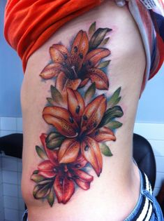 Tiger lily tattoo on ribs - Tattooimages. Lily Tattoo Design, Flower Tattoo Designs, Design Tattoos, Tattoo Trend, Tattoo On, Chest Tattoo, Side Tattoos, Body Art Tattoos, Tatoos