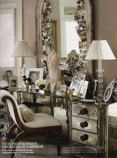 Glamorous dressing table paired with a rustic mirror provides the perfect backdrop for favorite photos, toiletries, and other pretties #dressing_room #vanity #mirrored #mirrors