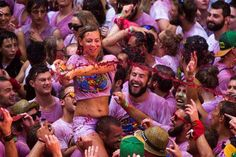 A woman throws wine during a party at the official opening of the 2015 San Fermin fiesta in Pamplona on July Simbolos Nova Era, Haro Spain, Running Of The Bulls, Wine News, Latest World News, The Eighth Day, Big Party, The Dunes, Famous Places