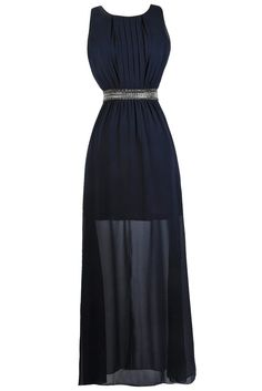 This gorgeous maxi dress would make a beautiful navy bridesmaid dress! We love that it is chic, demure, and glamorous at the same time. The Demure and Dazzling Embellished Navy Maxi Dress is fully lined to the mid-thigh. It is made entirely of chiffon and has a rounded neckline, wide shoulder straps, an empire waist, and a full length maxi cut. Vertical pleats of fabric at the bust add to the intricacy of this look. The best part of this dress has to be the silver grey chain and rhinestone…