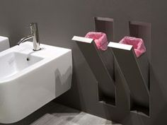 I LOVE THIS! --> Sesamo Collection by Antonio Lupi. Is an innovative collection that dramatically goes beyond the concept of bathroom accessories, making them invisible yet available only when necessary. The niches are made of stainless steel and can be coated with the same wall material. No limits to the type of finish, maximum hygiene and functionality.