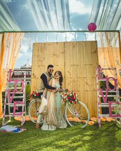 Photo Booth! Love is in the air! <3 this minimal yet fun ladder love booth with the cycle! the smiles on the couple say it all #Indianwedding #mehendi #weddingphotograph | Curated by #WittyVows - The ultimate guide for the Indian Bride | www.wittyvows.com