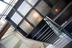 Kilnformed glass and metal staircase designed by Wayne Design Group and fabricated by Bullseye Studios, One Arts Plaza, Dallas