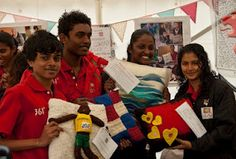 Fibre East 2012 - Maldives team collect their Woolsack cushions