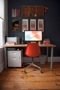 a rustic modern home office with a view // great orange chair // walls in valspar napoleon #workspace