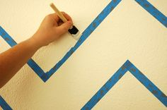 6. Paint the edges of each stripe in the way described above and allow the paint to dry completely.    7. Using your secondary color, paint your stripes inside the tape lines and carefully remove the tape before the paint dries.