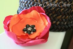 """Orange satin and fuchsia crushed satin w/ a 28mm black rhinestone button in d center on a black 3/8"""" elastic.Baby headband.Photo prop by TheColorfulClover, $9.45"""