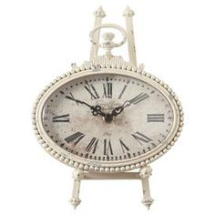 """Set of two pocket watch-inspired desk clocks in distressed ivory. Includes a stand.    Product: Set of 2 clocksConstruction Material: MetalColor: Distressed ivoryAccommodates: Batteries - not includedDimensions: 9"""" H x 6.5"""" W x 2.375"""" D each"""