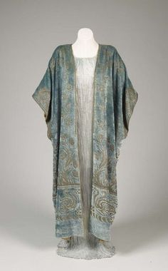 Silver Delphos dress and light blue wrap by Fortuny, c. 1925. From the De Young Museum.