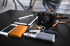 """Leica M6 """"Weekend essentials from @zachfoxers rocking a nicely aged black x natural legacy strap on his m6. #legacyshooters"""""""
