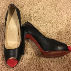 Red Bottom peep toe black leather heels Red bottoms peep toe leather heels. Worn as shown in pics. No scratches or tears on leather. Size 37 Christian Louboutin Shoes Heels