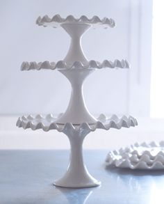 If I ever have tons of extra shelves in my kitchen, I think I will fill them with cake stands.
