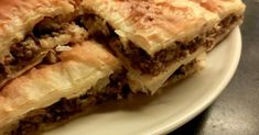 Bureek Tajin(also known as Suniyet Ruqaqin Egypt) is ameat pie served as a side dish, and is a popular accompaniment to soup duringRa...