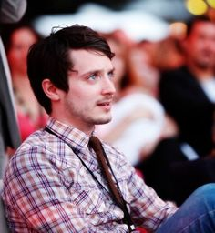 Elijah Wood << another of my favorite actors wearing plaid. I just love Elijah. And plaid.