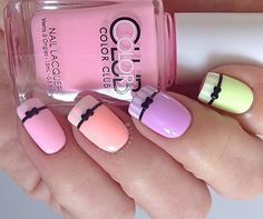 Pastel and stripes bow nail art. You can even add a bit of a French tip into the combination to make it even more dazzling.