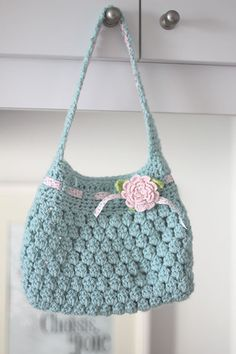 cute crochet bag. I like the flower and crochet ribbon trim.