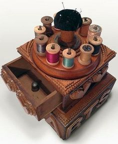 Tramp Art Sewing Box with Pincushion and Spool Holders.