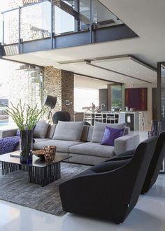 House Dukken is an open plan glass and steel home designed by Nico Van Der Meulen Architects