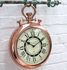 A copper wall clock in a stop watch design.This copper stop watch wall clock would look great on any kitchen or study wall. It's cream face makes it great against most colour schemes and it would make a great gift for a Dad at Christmas or Father's day. It can be hung off a hook or against a wall.MetalH: 440mm