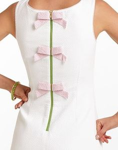 Love those bows, though the zipper is all wrong... still I think it's pretty cute...