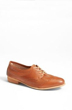 Dainty perforations revamp a menswear-inspired oxford secured with slender contrast laces.  Leather upper/synthetic lining/rubber sole. By Hinge