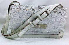 Brand new BCBG white sequins purse, $45.