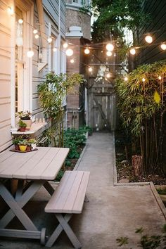 Small patio with bistro lights and picnic table