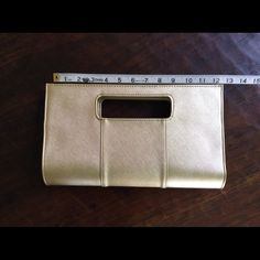 Charming Charlie's Gold Clutch Beautiful charming Charlie's Gold Clutch. Two snaps for closure. Used one time to a Christmas party.  EUC. Smoke free, pet friendly home. Charming Charlie Bags Clutches & Wristlets