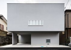 This house was designed with strategically placed windows to create privacy for residents in a densely populated area of Japan.
