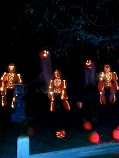 Creepy grave yard scene featuring Jack o lanterns