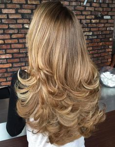 Long Flicked Layered Hairstyle