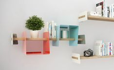 Philosophy Slide Shelf System embraces decoration as an integral part of organization for the twenty first century. As our lives become more dematerialized we keep only the things we love or need. Slide aims at giving those objects order and a s Cheap Furniture Stores, Smart Furniture, Modular Furniture, Furniture For Small Spaces, Furniture Outlet, Furniture Projects, Contemporary Furniture, Furniture Design, System Furniture