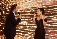 Demi Lovato and Olly Murs performing at the UK X Factor Finale
