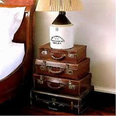 old suitcases stacked for end tables