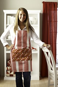 Customize the cook's look: Transform a purchased tea towel into an apron and add a pocket made of a cotton print.