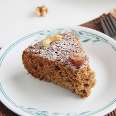 Cake prepared with dates and walnuts which is soft and yummy.
