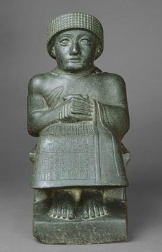 Mesopotamian, Sumerian. seated statue of Gudea. 2150-2100 B.C.  Man wearing kaunakes garment in the form of a wrapped skirt, the end  of the skirt is thrown over the left shoulder.