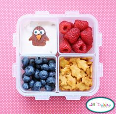 from meet the dubiens blog    Yogurt with fruit leather penguin (icing eyes and carrot nose), raspberries, blueberries and whole wheat penguin crackers.