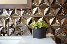 Ann Sacks has partnered with ceramicist Daniel Ogassian to introduce its new Ogassian tile line, a blend of Old World hand-craftmanship with modern technology.Handmade tiles can be colour coordianated and customized re. shape, texture, pattern, etc. by ceramic design studios